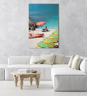 Italian lifeguard sitting under umbrella with boat at blue water on Monterosso Beach in an acrylic/perspex frame
