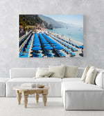 Rows of blue umbrellas along blue mediterranean sea in Cinque Terre in an acrylic/perspex frame