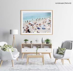 Beach goers lying on sand at italian beach in a natural fine art frame