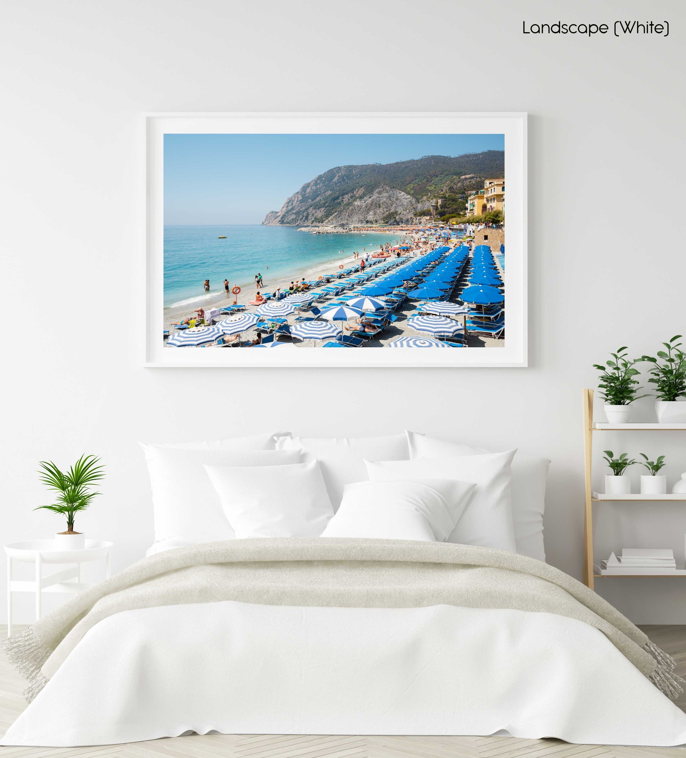 People and umbrellas at Monterosso beach Cinque Terre during summer in a white fine art frame