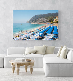 People and umbrellas at Monterosso beach Cinque Terre during summer in an acrylic/perspex frame