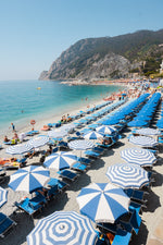 People and umbrellas at Monterosso beach Cinque Terre during June