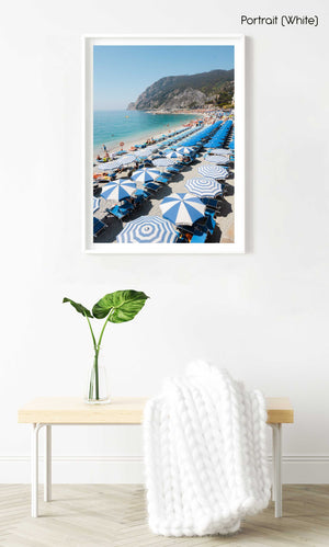 People and umbrellas at Monterosso beach Cinque Terre during June in a white fine art frame