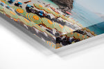Orange striped umbrellas on beach in Italy with blue water and a boat arriving in an acrylic/perspex frame