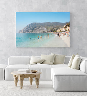 Hot sunny day with people swimming at Monterosso beach Italy in an acrylic/perspex frame