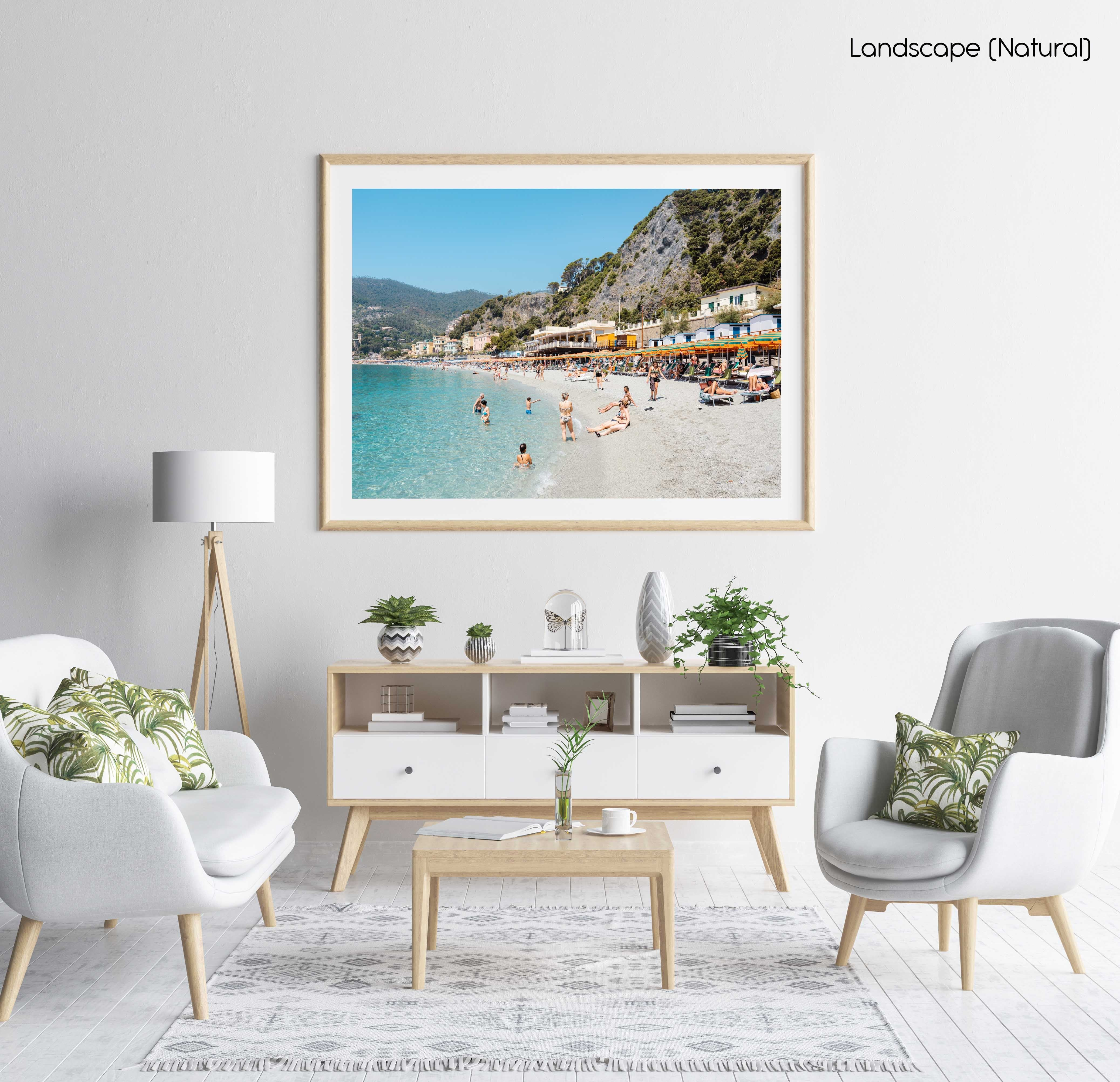 People swimming and sitting at colorful Monterosso beach in Cinque Terre in a natural fine art frame