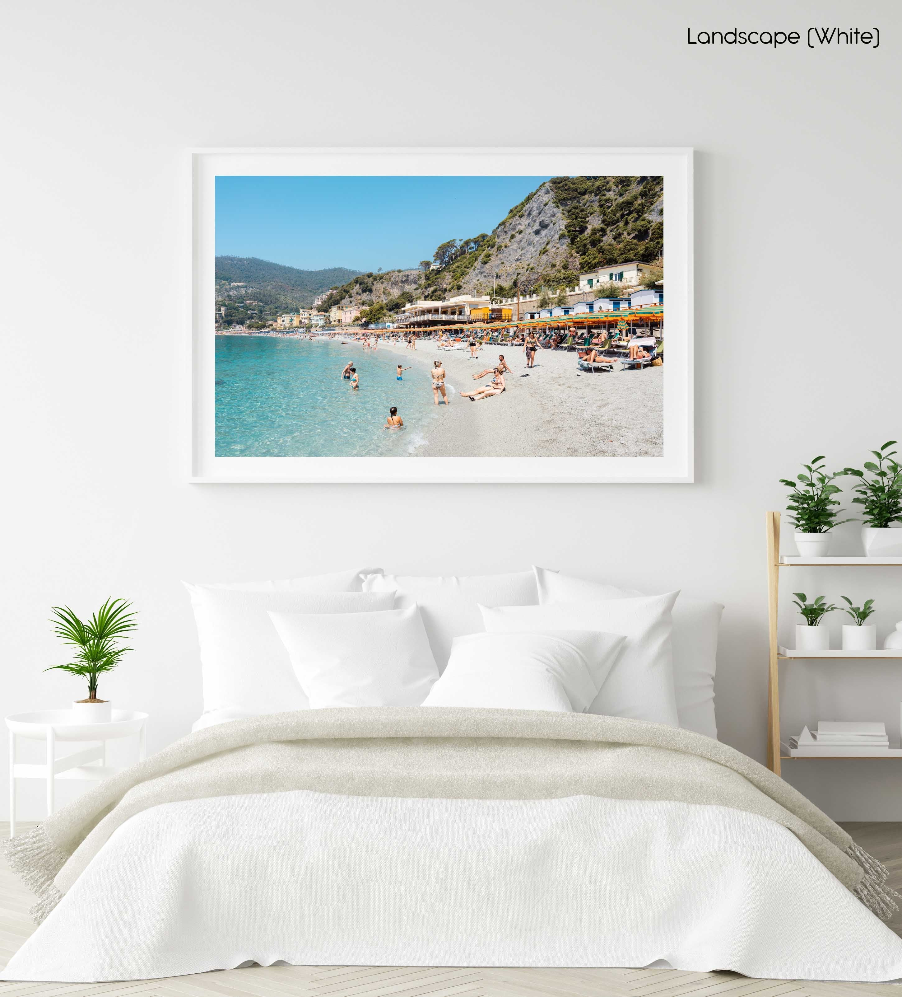 People swimming and sitting at colorful Monterosso beach in Cinque Terre in a white fine art frame