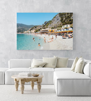 People swimming and sitting at colorful Monterosso beach in Cinque Terre in an acrylic/perspex frame