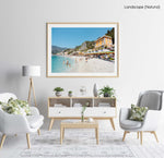 People swimming and sitting at colorful Monterosso beach in Italy in a natural fine art frame