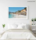 People swimming and sitting at colorful Monterosso beach in Italy in a white fine art frame