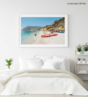 Italian vibes along Monterosso beach with people swimming and lying at water in a white fine art frame