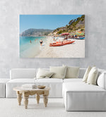 Italian vibes along Monterosso beach with people swimming and lying at water in an acrylic/perspex frame