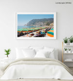 Orange umbrellas and people tanning on Monterosso Beach Cinque Terre in a white fine art frame