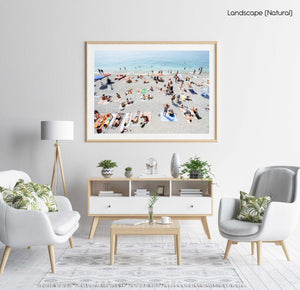 People lying on Monterosso beach with pebbles in Cinque Terre in a natural fine art frame