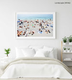 People lying on Monterosso beach with pebbles in Cinque Terre in a white fine art frame