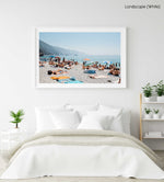 People lying on towels in the sun on Monterosso beach in Cinque Terre in a white fine art frame