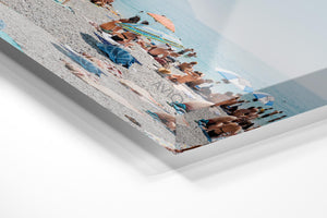 People lying on towels in the sun on Monterosso beach in Cinque Terre in an acrylic/perspex frame