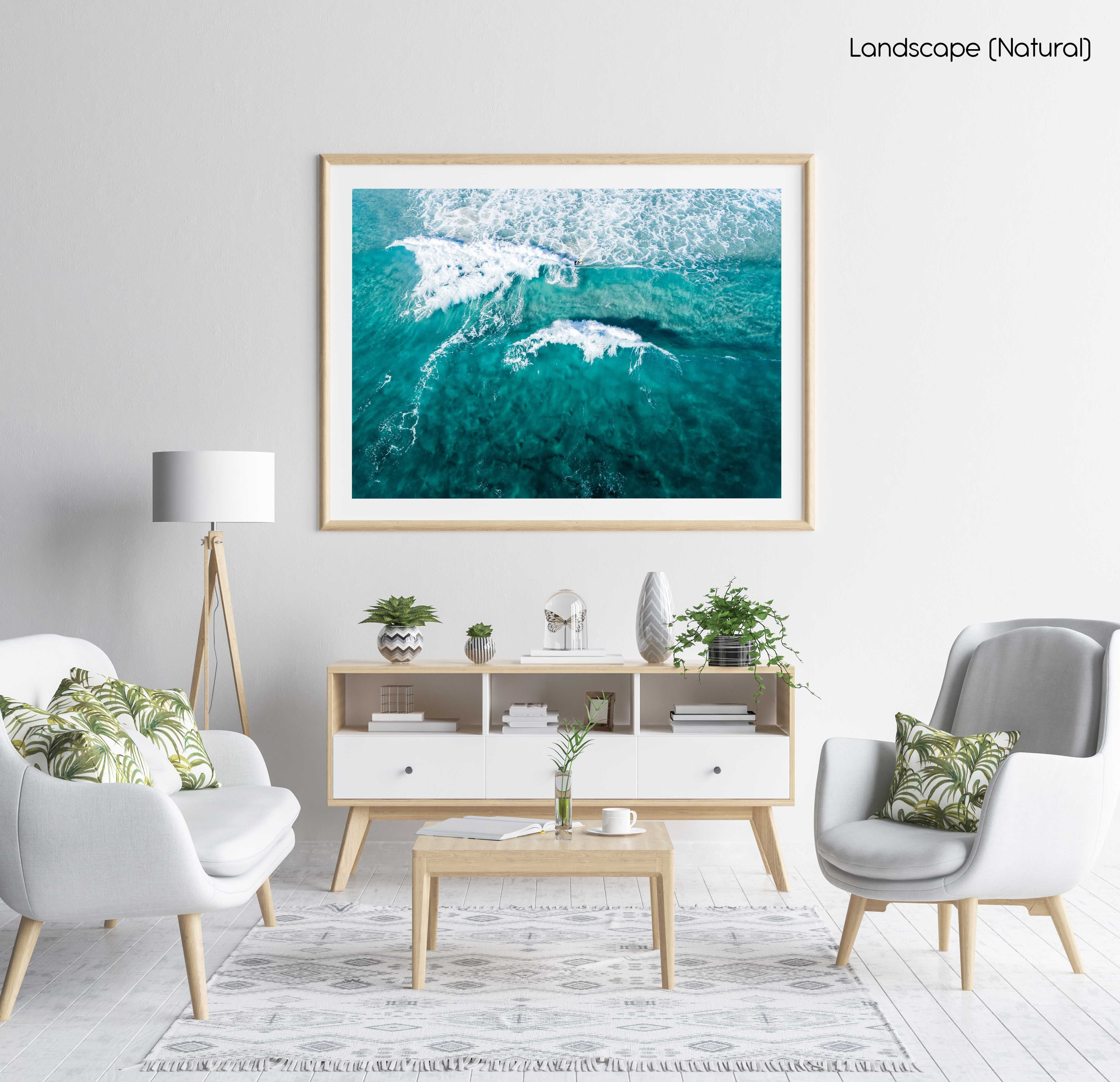 Aerial of two waves breaking in blue ocean in Cape Town in a natural fine art frame