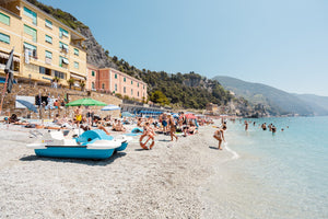 People swimming and lying on italian beach during summer