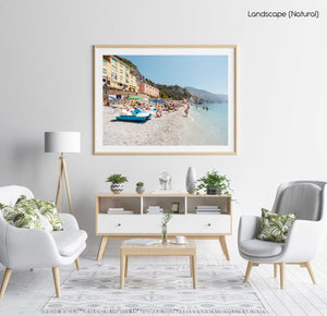 People swimming and lying on italian beach during summer in a natural fine art frame
