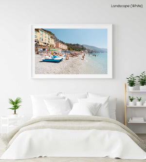 People swimming and lying on italian beach during summer in a white fine art frame