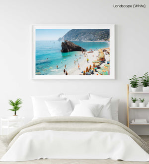 Big rock on Monterosso beach surrounded by people and blue water Cinque Terre in a white fine art frame