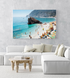 Big rock on Monterosso beach surrounded by people and blue water Cinque Terre in an acrylic/perspex frame