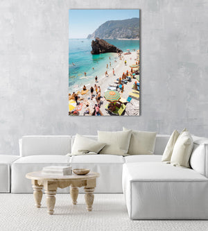 Big rock on Monterosso beach surrounded by people and blue water in Italy in an acrylic/perspex frame