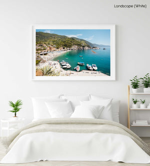 Boats docked along promenade of old town Monterosso during summer in Cinque Terre in a white fine art frame