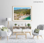 The old town of monterosso with people on beach and green hills in a natural fine art frame