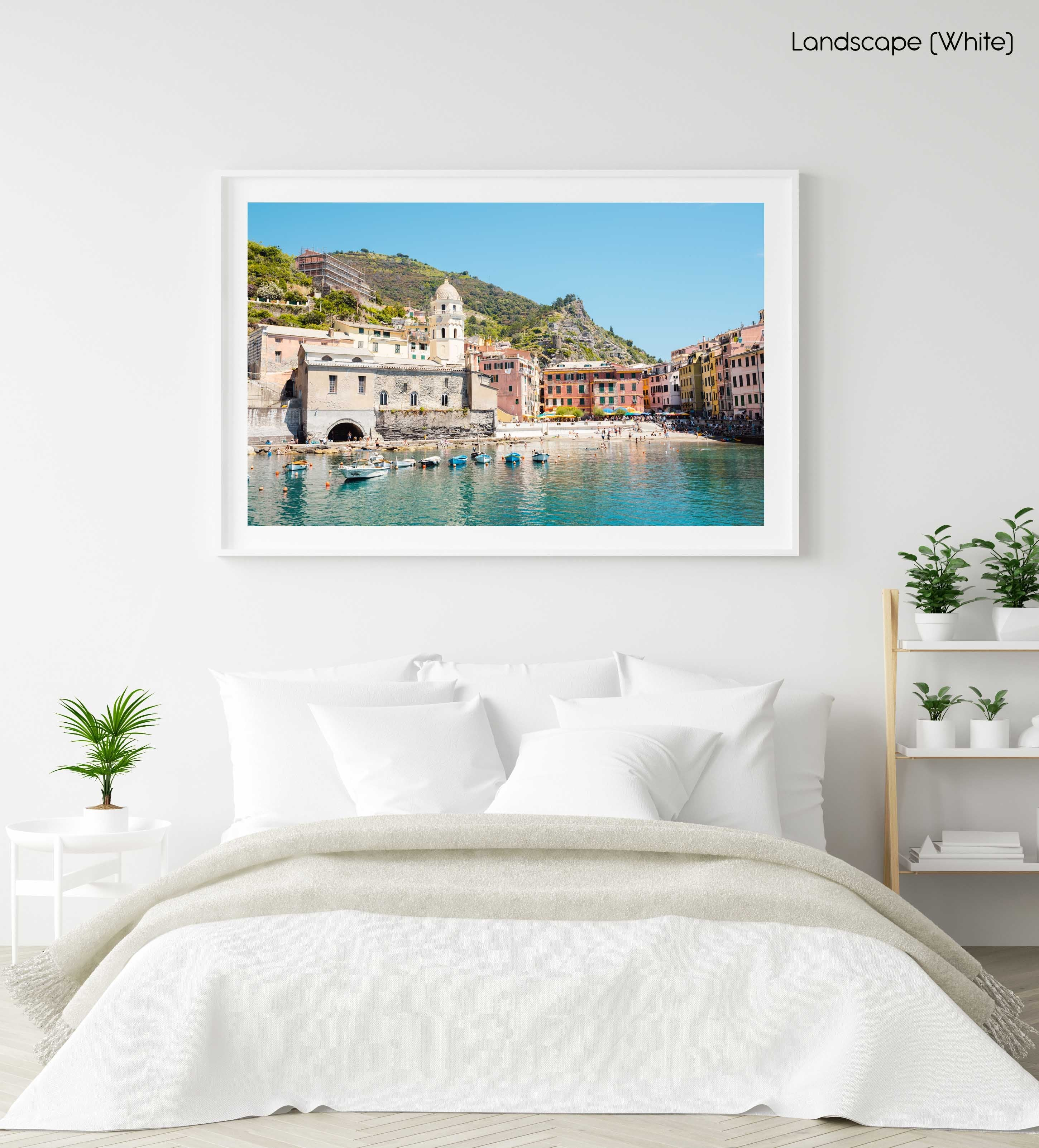 Beach, boats and colorful buildings of Vernazza in Cinque Terre in a white fine art frame