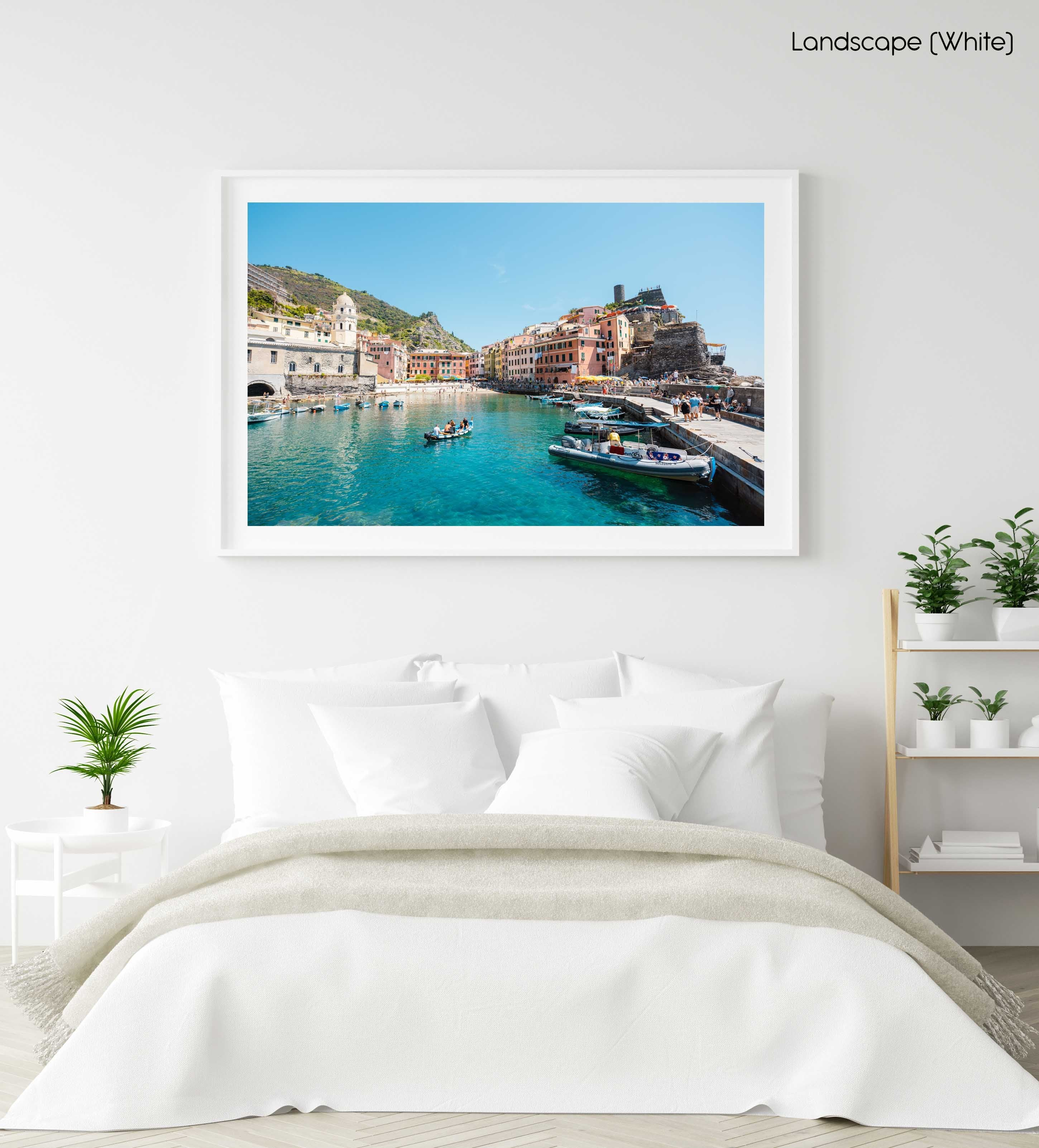 People on boat in blue water in colorful Vernazza of Cinque Terre in a white fine art frame