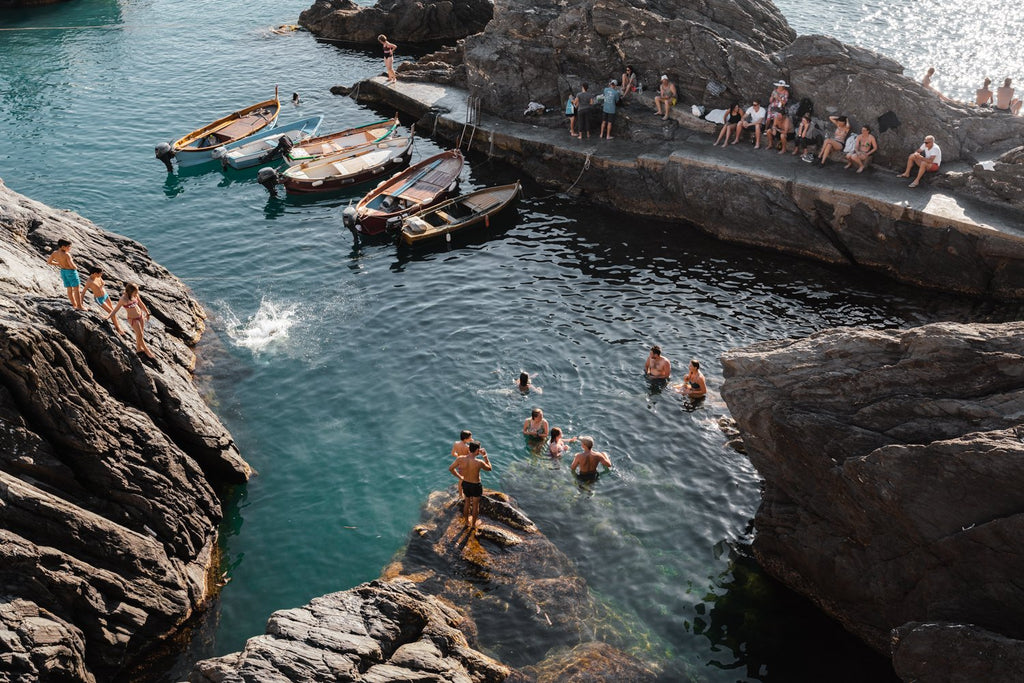 People jumping off rocks at Manarola in Cinque Terre