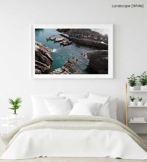 People jumping off rocks at Manarola in Cinque Terre in a white fine art frame