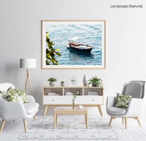 Man driving a rental boat along Cinque Terre coastline in a natural fine art frame