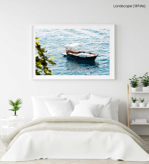 Man driving a rental boat along Cinque Terre coastline in a white fine art frame