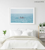Two women paddling a red kayak in Cinque Terre in a white fine art frame