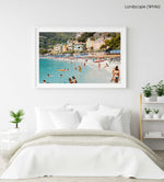 Busy Monterosso beach with people swimming, snorkeling and chilling on summers day in a white fine art frame
