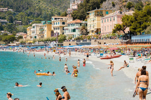 Busy Monterosso beach with people swimming, snorkeling and chilling on summers day
