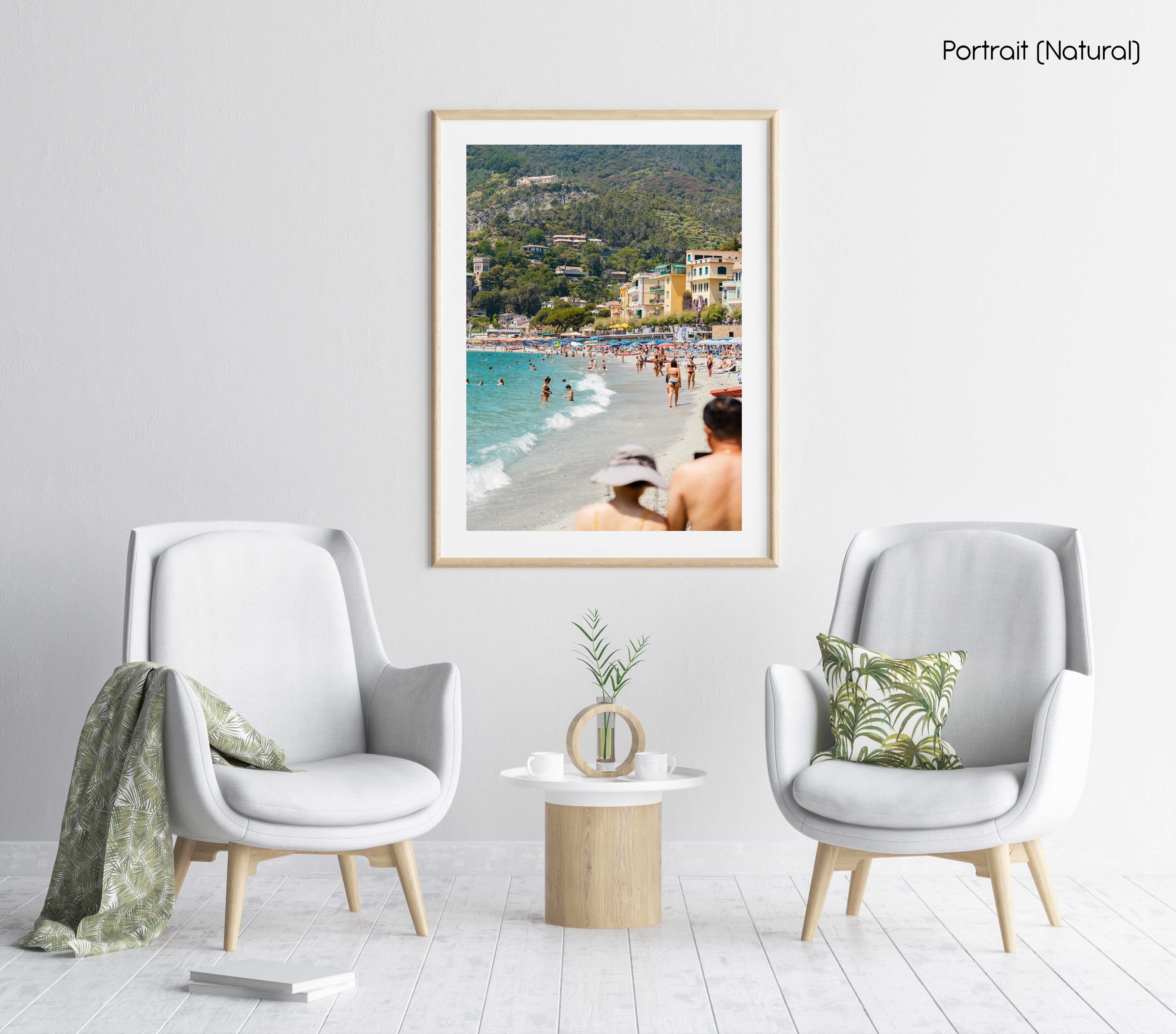 People walking and swimming in blue water of Monterosso beach in Cinque Terre in a natural fine art frame