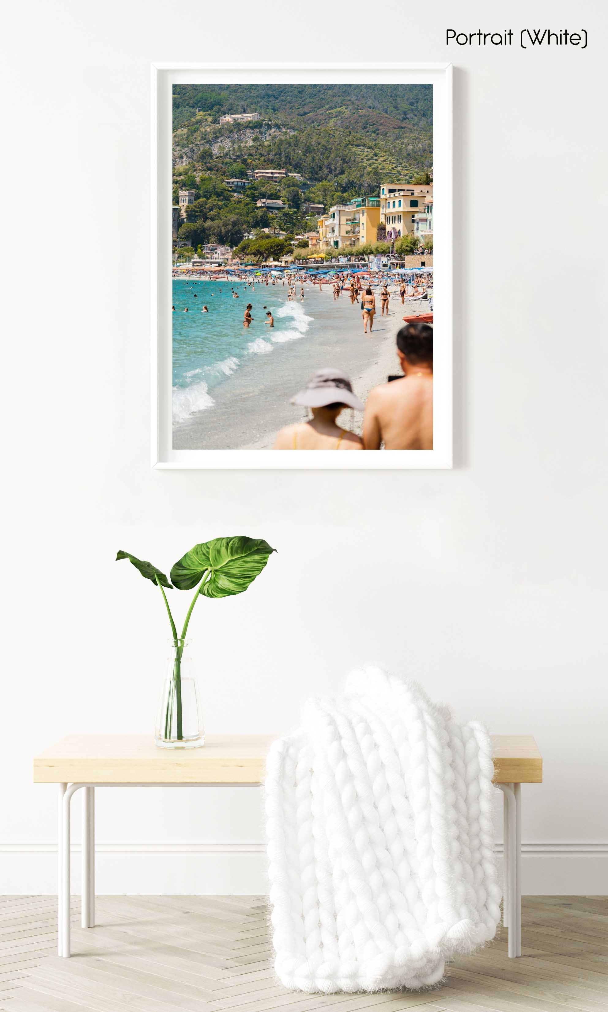 People walking and swimming in blue water of Monterosso beach in Cinque Terre in a white fine art frame