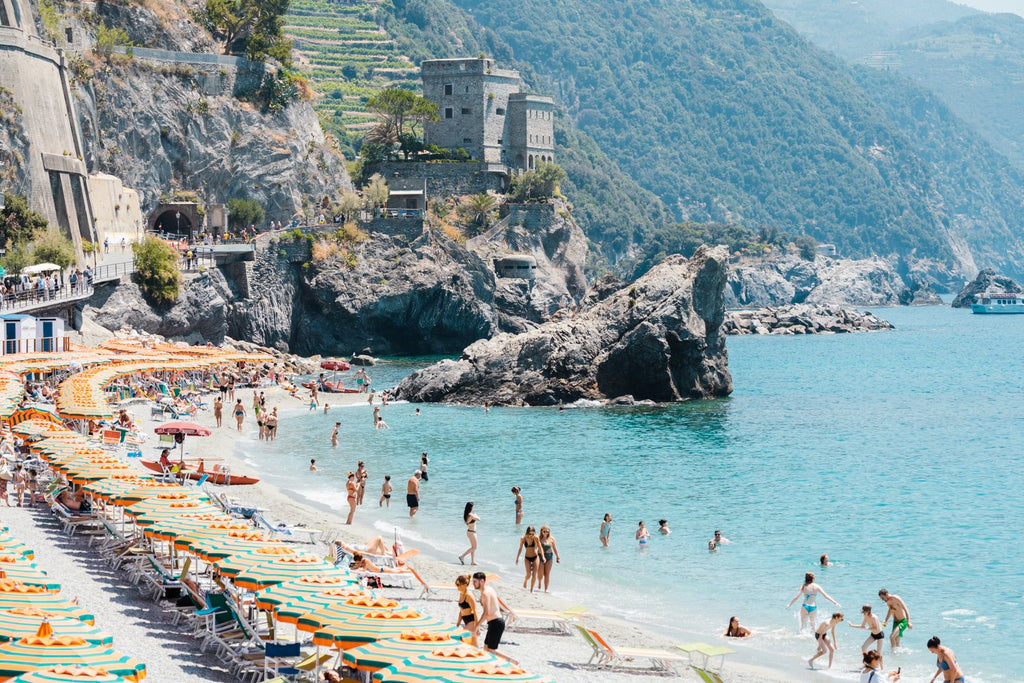 People enjoying the sun and ocean in Cinque Terre