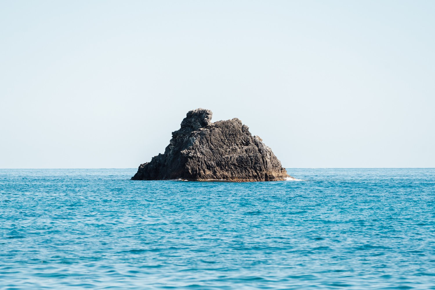 Big rock in middle of blue ocean Cinque Terre