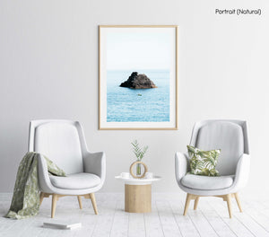 Man paddling in kayak at big rock in blue ocean in Cinque Terre in a natural fine art frame
