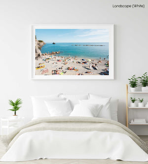 Lots of people lying on old town Monterosso beach in Italy in a white fine art frame