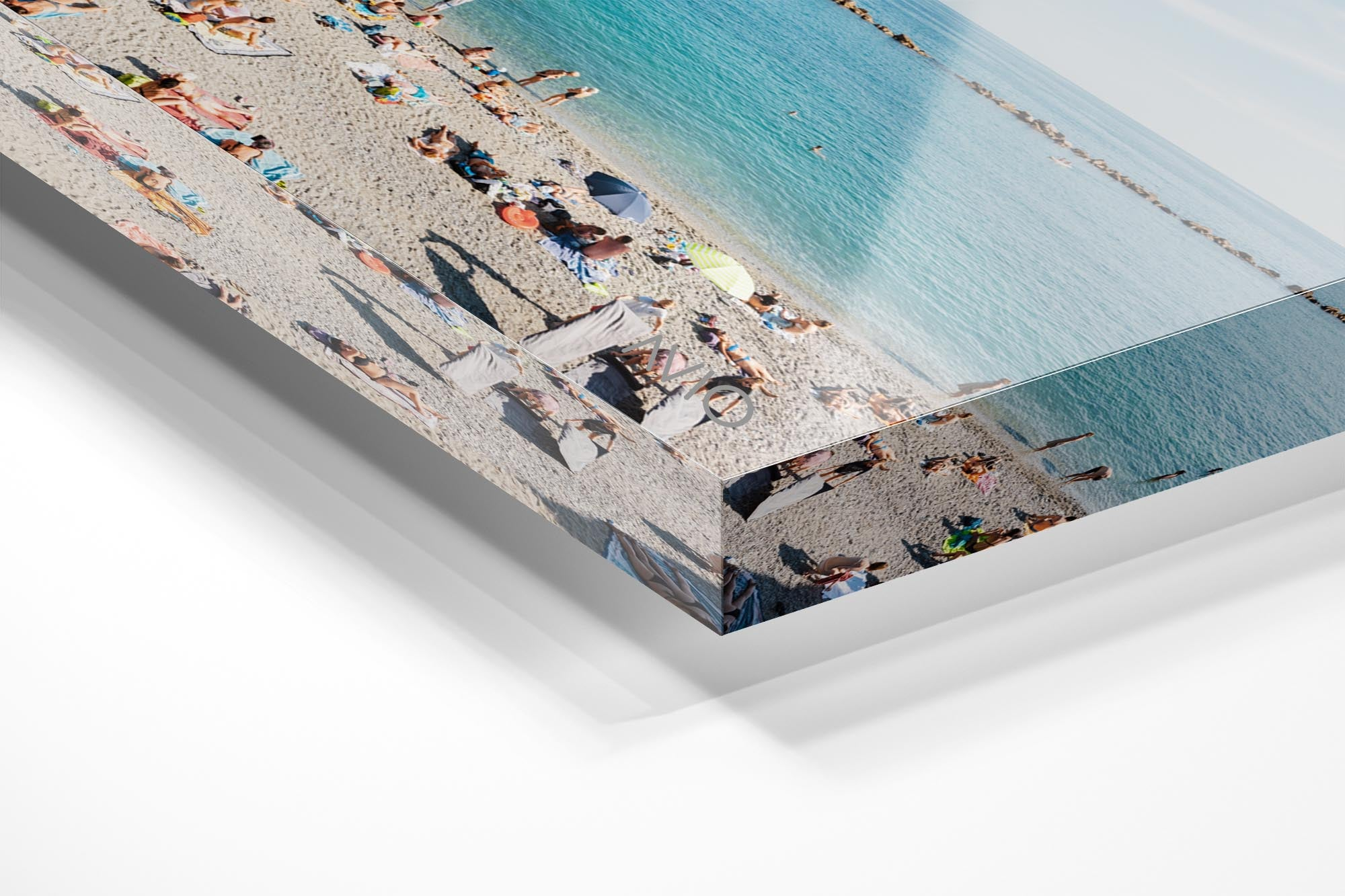 Lots of people lying on old town Monterosso beach in Italy in an acrylic/perspex frame