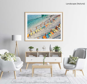 Orange, green and blue chairs on beach in Cinque Terre in a natural fine art frame