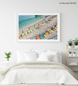 Orange, green and blue chairs on beach in Cinque Terre in a white fine art frame