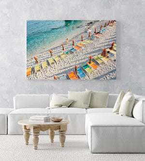 Orange, green and blue chairs on beach in Cinque Terre in an acrylic/perspex frame