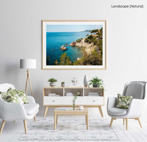 Green trees and bright blue water along Costa Brava coast in a natural fine art frame